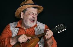 Depresja kluczowy portret starszy muzyk z mandoliną fotografia royalty free