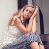 Depresji kobieta indoors Obraz Stock