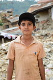 Depress boy after earthquake disaster Royalty Free Stock Image