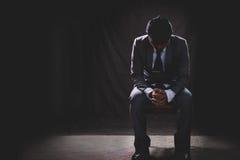 Depress business mature man sitting in the dark Stock Photos