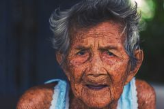 Depress and helpless elderly woman, grandma sitting outdoor wait. Ing for children come back home Royalty Free Stock Images