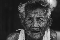 Depress and helpless elderly woman, grandma sitting outdoor wait. Ing for children come back home in white tone Royalty Free Stock Images
