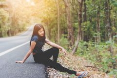 Depress and hopeless , Asian woman sitting on roadside. Waiting for help Stock Images