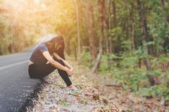 Depress and hopeless , Asian woman sitting on roadside. Waiting for help Stock Photo