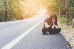Depress and hopeless , Asian woman sitting on roadside. Waiting for help Royalty Free Stock Photography