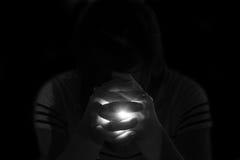 Depress woman praying in the dark Stock Image