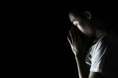 Depress woman praying in the dark  praying in secret room conce Royalty Free Stock Images