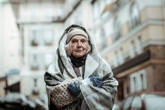 Depressed åldrig kvinna som har ett svårt liv royaltyfria foton