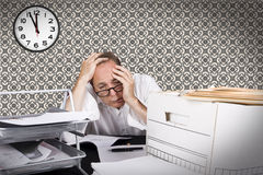 Depressed. Overworked businessmen depressed by his working condition Stock Images
