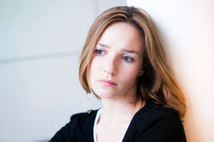 Depressed. Sad woman in the living room Royalty Free Stock Photography