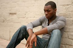 Depressed  African American Man Leaning Against Al Stock Image