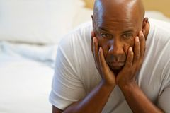 Depressed African American man. Portrait of a depressed African American man Stock Images