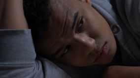 Depressed afro-american teenager thinking about life problems, mental health