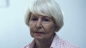 Depressed aged woman looking at camera, health and life problems, poverty. Stock footage stock footage