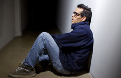 Depressed and Alone in a Hallway Stock Photo