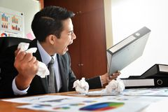 Businessman is yelling. Depressed Angry Young Asian Businessman is yelling. Angry. Stress Royalty Free Stock Photos