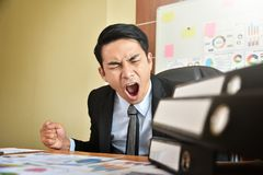 Businessman is yelling. Depressed Angry Young Asian Businessman is yelling. Angry. Stress Stock Photography