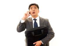 Depressed Asian businessman. Royalty Free Stock Photos
