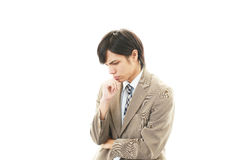 Depressed Asian businessman. Royalty Free Stock Photos