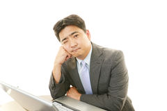 Depressed Asian businessman. Stock Photography