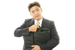 Depressed Asian businessman Stock Image