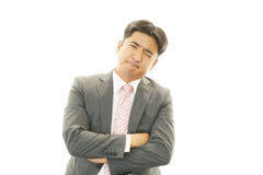 Depressed Asian businessman. Stock Photo