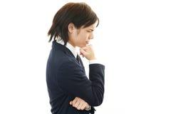 Depressed Asian businessman Royalty Free Stock Photos