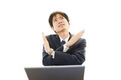 Depressed Asian businessman Stock Images