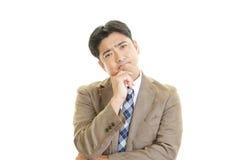 Depressed Asian businessman. Royalty Free Stock Photo