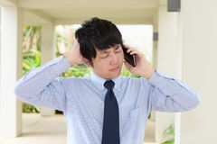 Depressed Asian businessman Stock Photo