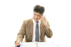 Depressed Asian businessmen Royalty Free Stock Photo