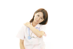 Depressed Asian female nurse Royalty Free Stock Image