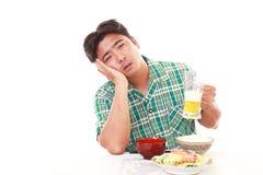 Depressed Asian man. Depressed Asian man isolated on white background Royalty Free Stock Image