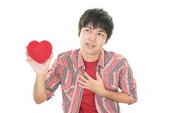 Depressed Asian man. With a red heart Stock Photography