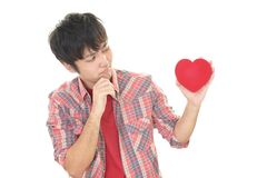 Depressed Asian man. With a red heart Stock Photos