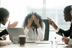 Depressed black woman leader suffering from gender discriminatio. Upset depressed black women leader suffering from gender discrimination inequality at work royalty free stock image