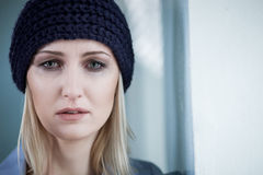 Depressed blond female druggie is weeping for. Lonely young woman is standing and crying. The drug addict is looking at camera with frustration. Copy space in Stock Photos