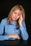 Depressed blonde older woman Royalty Free Stock Images