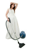 Depressed bride with vacuum cleaner Royalty Free Stock Photography