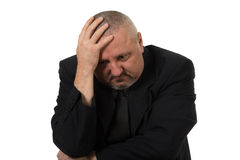 Depressed business man. Isolated on white background Royalty Free Stock Photography