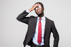 Depressed Business man over tired and depressed on grey background. Depressed Business man having an headache on grey Royalty Free Stock Photography