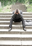 Depressed business man on stairs Royalty Free Stock Photo