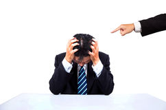 Depressed businessman. And Accused's hand stock photo