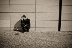 Depressed businessman stock image