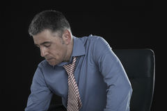 Depressed Businessman Against Black Background Royalty Free Stock Photo