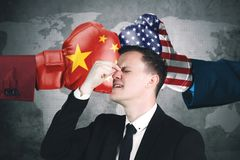 Depressed businessman with conflict China and USA Stock Images