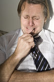 Depressed businessman crying. A colour portrait photo of a depressed forties businessman crying Royalty Free Stock Image