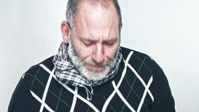 Depressed businessman crying stock footage