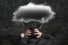 Depressed businessman with dark cloud rain lightning over his he Royalty Free Stock Photo