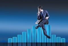 The depressed businessman in despair in crisis concept Stock Photos